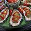 Auster mit scharfer Soße