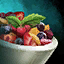 Bowl of Fruit Salad with Mint Garnish