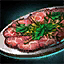 Plate of Beef Carpaccio with Mint Garnish